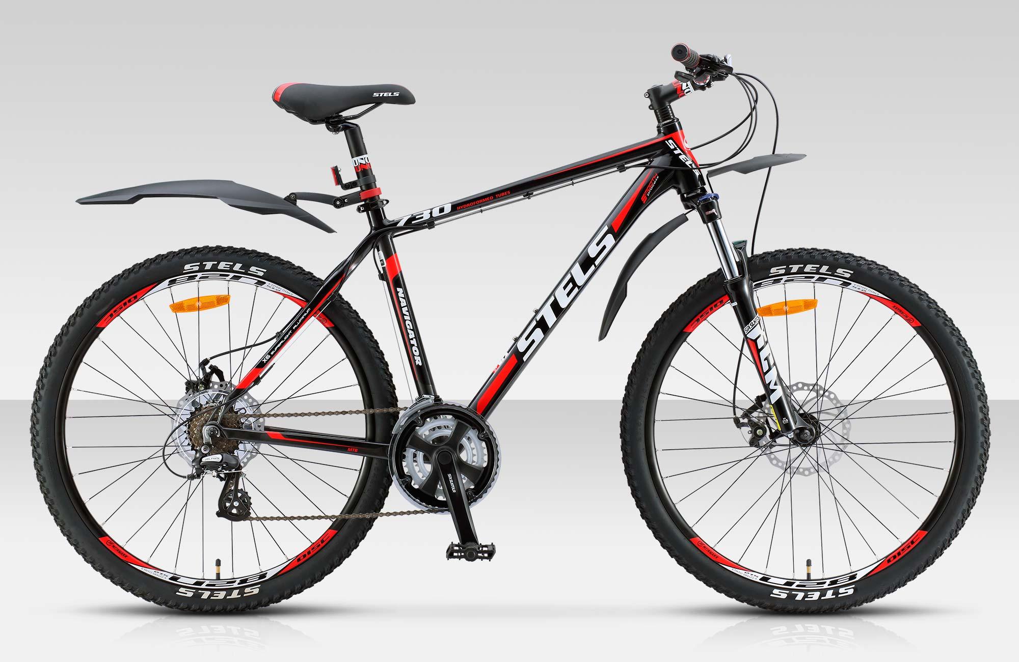 Велосипед Stels Navigator-730 MD 27.5.14Велосипеды Stels<br>Горный велосипед Stels Navigator 730 MD 27.5 2015 года – отличный вариант для любителей кросс-кантри. Модель отличается превосходной управляемостью, стильным брутальным дизайном и высокой износостойкостью. Установлены вилка SR SUNTOUR XCM с ходом 100 мм,...<br>