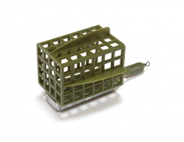Кормушка Limanfish пластик квадрат 120гр (дно+стабилизаторы) KB-120ПП (85670)Фидерная и карповая оснастка<br>Корпус кормушки из пластика, устойчива к ударам. Кормушка оснащена дном , которое за счет эластичности при желании легко удаляется с помощью ножа. На кормушке установлен уникальный груз со смещенным центром тяжести. По форме груз плоский, что позволяет ко...<br>